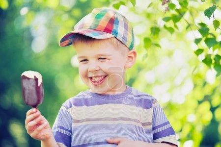 Cute boy staring at an ice cream