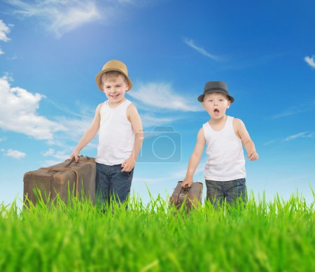 Fancy picture of two boys running with luggages