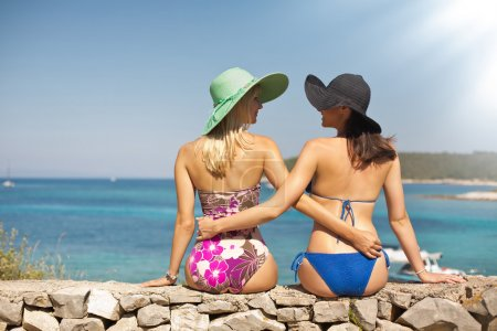 Summer shapely girls on the beach