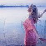 Art photo of blonde female model walking in the wa...