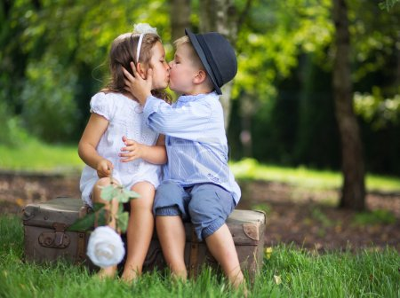 Cute couple of children kissing each other