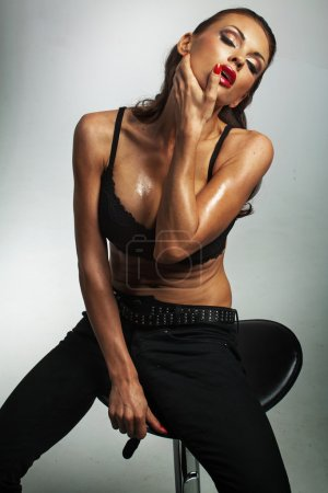 Sexy female model posing wearing black bra