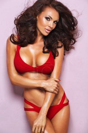 Desireble brunette woman wearing red lingerie