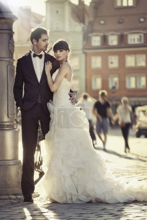 Young attractive marriage couple in the old town