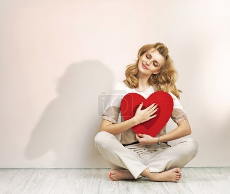 Photo for Relaxed young woman with valentine's sign - Royalty Free Image