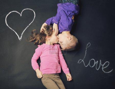 Smiling kids on a blackboard background