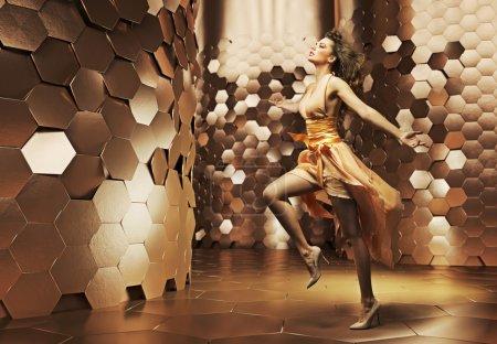 Dancing young woman wearing fabulous dress