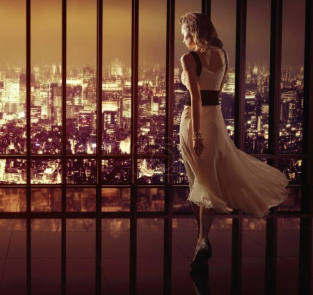 Photo for Lady walking on the top of the skyscraper - Royalty Free Image