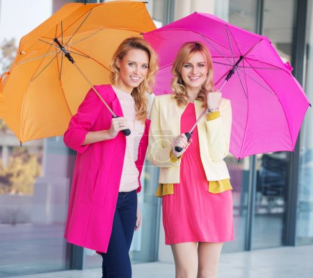 Photo for Blonde ladies with colorful umbrellas - Royalty Free Image