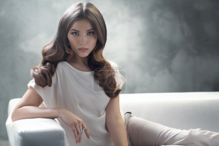 Elegant young woman with excellent classic hairstyle