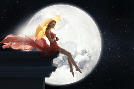 Lady with umbrella over full moon background...