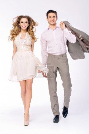 Elegant joyful couple walking together