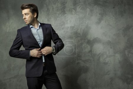 Succesful young manager wearing suit
