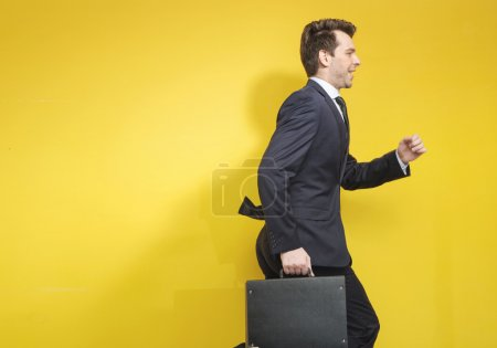 Photo for Succesful businessman with the black suitcase - Royalty Free Image
