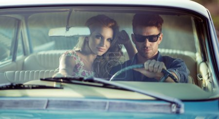 Car potrait of the young couple