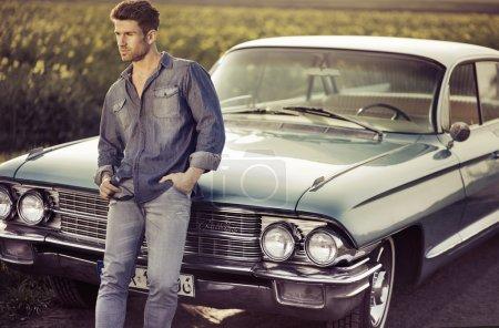 Elegant male model with the retro car