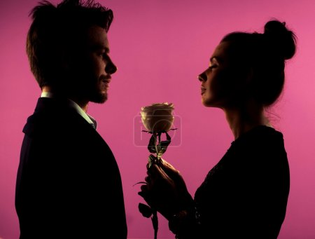 Silhouette of a couple and the rose
