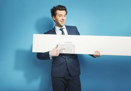 Photo for Smart banker with the empty white board - Royalty Free Image