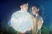 Conceptual photo of the couple holding the Earth