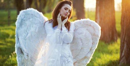 Satisfied angel heated by the sun beams