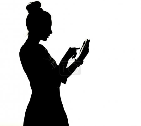 Silhouette of a woman uisng the smartphone
