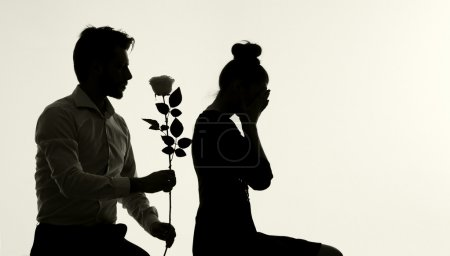 Husband apologizing his lovely wife