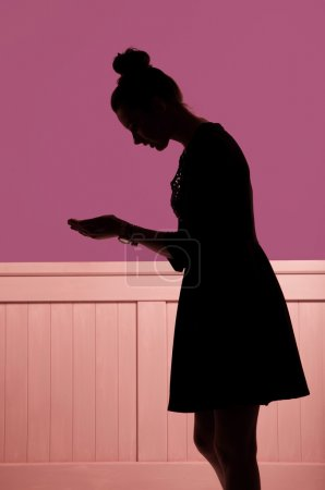 Picture presenting silhouette looking at the hands