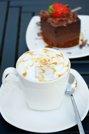 Cup of coffee with a chocolate cake