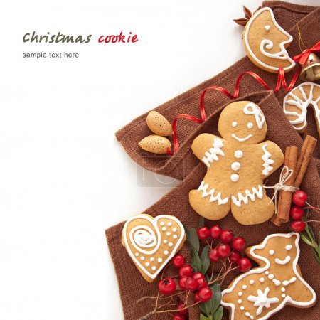 Photo for Gingerbread cookies and spices over white background close up - Royalty Free Image