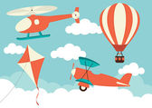 Illustration of a helicopter plane kite and hot air balloon in the clouds