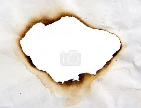 Photo pour Cadre de trou brûlé dans un papier - image libre de droit
