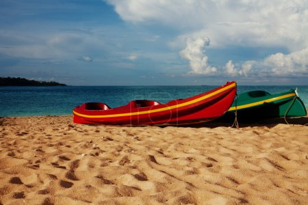 Two kayaks laying on sand