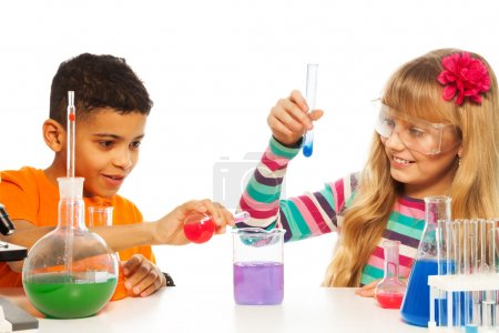 Kids experimenting in chemistry