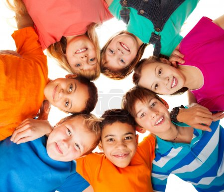 Photo for Circle of smiling positive kids looking down - diversity group of boys and girls - Royalty Free Image