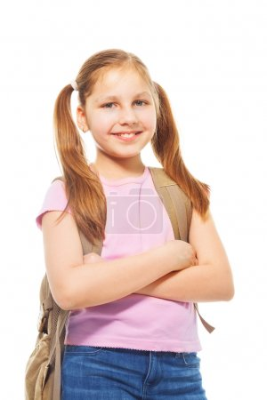 Photo for Happy smiling 9 years old girl with ponytails, wearing backpack, isolated on white - Royalty Free Image