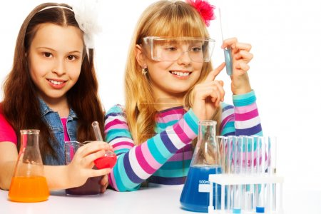 Two girls in chemistry class