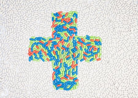Photo for Medical cross symbol made of drug pills put into shape as mosaic - Royalty Free Image