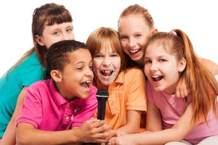 Portrait of kids singing together