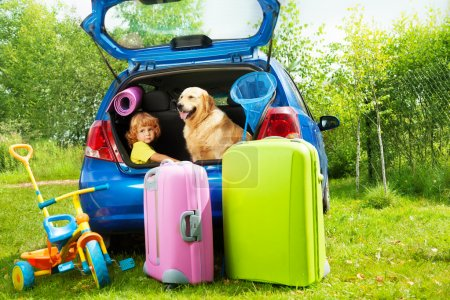 Kid, dog and luggage waiting for depature