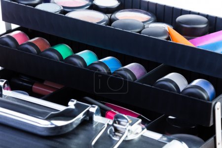 shelves in open makeup case