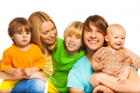 Photo for Happy parents and their kids hugging together on white - Royalty Free Image