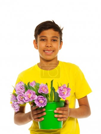 Boy holding tulips