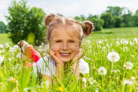 Girl laying on a grass