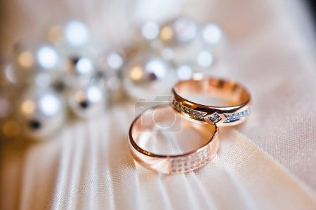Photo for Gold wedding rings on the pincushion - Royalty Free Image