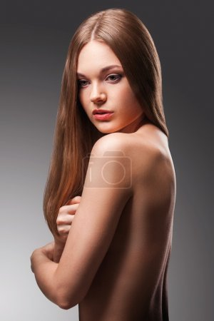 Beautiful woman with naked back portrait