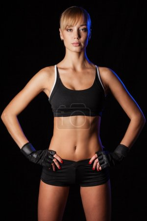 Athletic woman over dark background