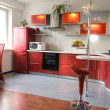 Постер, плакат: Interior of modern kitchen with a bar counter in red tones