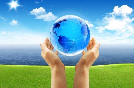 Globe and hand