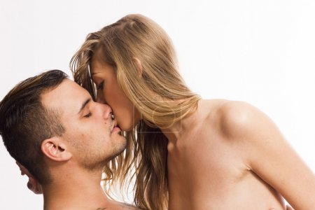 Sexy passionate young couple on white isolated background
