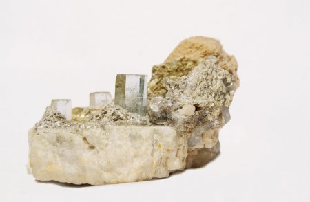 Three clear terminated aquamarine crystals on albi...